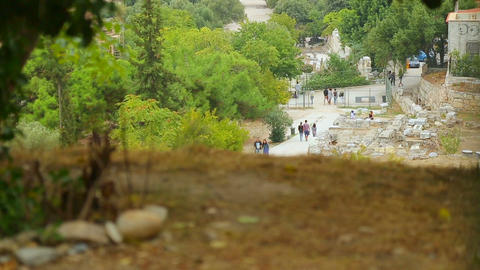 Many tourists walking by remains of Agora of Athens, ancient gathering place Footage