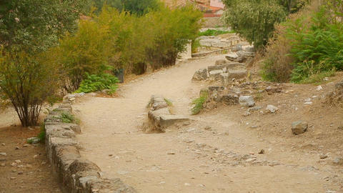 Old road with remains of stone constructions, archaeological excavations site Footage