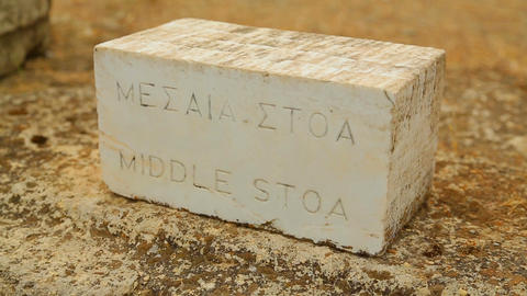 English and ancient Greek inscription Middle Stoa on stone table for tourists Footage