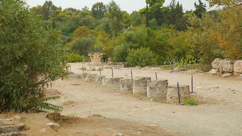 Archaeological excavation site in Greece, remains of antique column walkway Footage