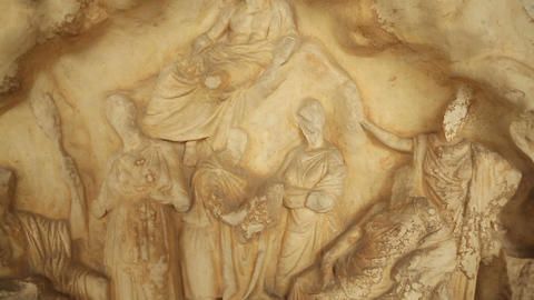 Close-up shot of marble relief depicting god Pan and Nymphs, Greek mythology Live Action