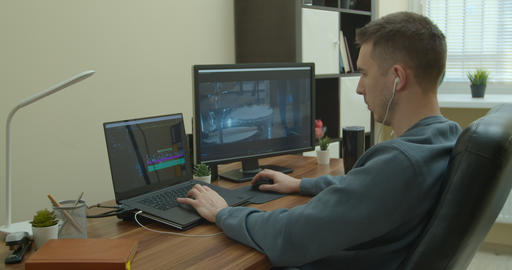 Video editing on a computer with Two Monitors. Monitor the computer and capture Live Action