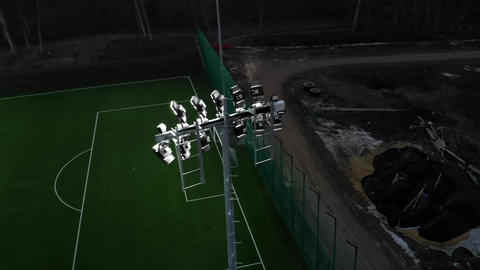 football field that is lit up in the night. Flying over illuminated devices that Live Action