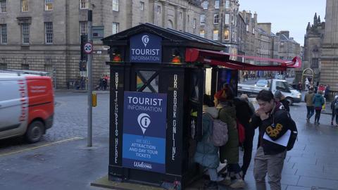 Tourist Information desk in Edinburgh Live Action