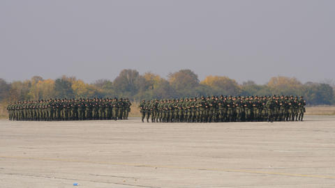 Marching Soldiers with Combat Equipment in Mimetic Camouflage of Special Forces Live Action