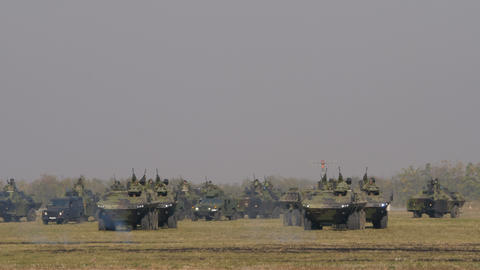 Mimetic Armored Vehicles of Serbia Army Military Equipment in a Battlefield Live Action