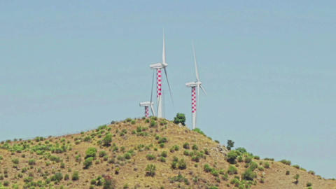 wind turbine alternative renewable energy on hills background Live Action