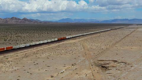 Cargo locomotive railroad engine crossing Arizona desert wilderness Live Action