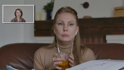 Charming Caucasian woman drinking tea and listening to friend talking on Live Action