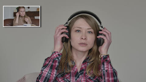 Young Caucasian blond woman putting on headphones and greeting colleague on Live Action