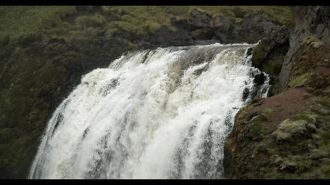A large waterfall Scogaffos in Iceland Live Action