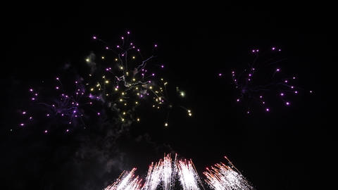 Abstract Fireworks show in the night sky, isolated on black background Live Action