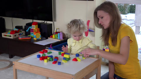 mother and cute daughter play with wooden pads. fine motor skills education. 4K Live Action