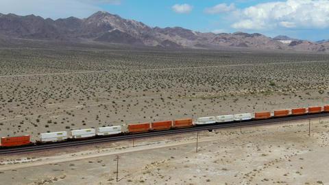 Cargo locomotive railroad engine crossing Arizona desert wilderness. USA Live Action