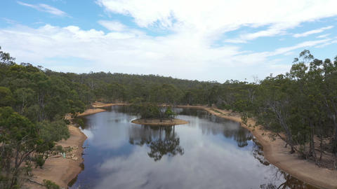 Drone aerial footage of a drought affected water reservoir in outback Australia Live Action