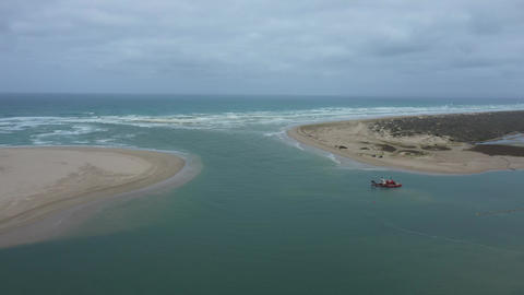 Drone aerial footage of a sand dredger at the mouth of the Murray River in South Australia Live Action