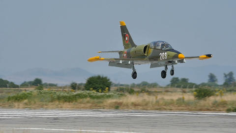 Green Camouflage Military Light Combat Jet Aircraft Landing in Slow Motion Live Action