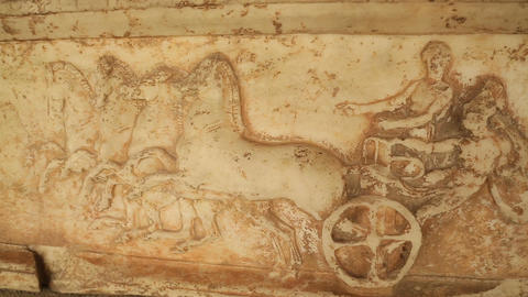Antique marble stone relief showing chariot racers at ancient Panathenaic Games Footage