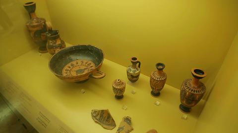 Ancient Greek pottery art exhibits at Agora museum, clay kylix, jars, vases Footage