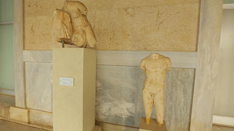 Timelapse of person viewing exhibits, statues at ancient Agora museum in Athens Footage