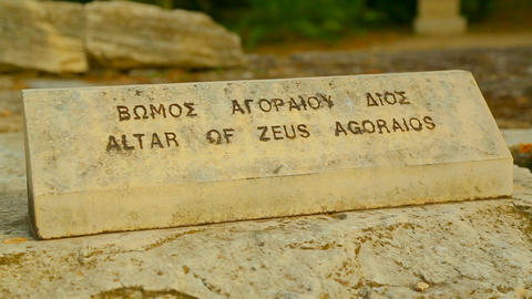 Altar of Zeus Agoraios inscription in English and ancient Greek on marble stone Footage