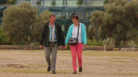 Middle age couple walking by the hand, spending time together, family travel Footage