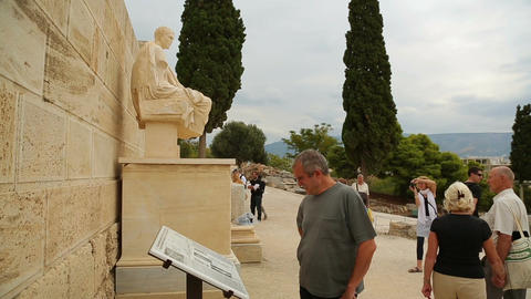 Tourists view statue of famous ancient Greek dramatist Menandre, sculpture art Footage