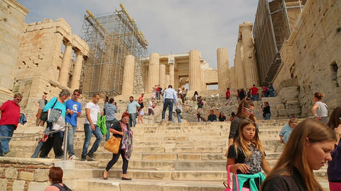 Crowd of travellers viewing ruins of Parthenon temple, place of tourist interest Live Action