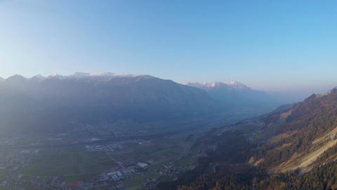Majestic panoramic view of mountain range in sun rays, magic hour, blue sky Footage