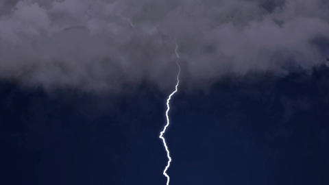 Rapid lightning forks strike in clear night sky, the destructive power of nature Footage