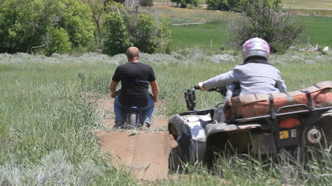 ATV motorcycle on dirt track P HD 0858 Live Action