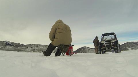 Adult friends ice fishing winter mountain lake HD 0230 Footage