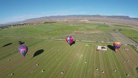 Aerial farm land rural hot air balloons landing HD 055 Footage