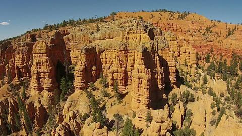 Aerial flight down red rock mountain pinnacles Utah HD 121 Footage
