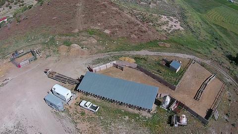 Aerial over rural farm livestock barns HD 010 Footage