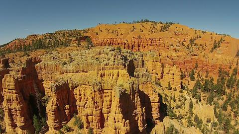 Aerial red rock mountain Pinnacles towers Utah HD 119 Footage