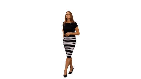 An elegant woman walking & watching something, 4k alpha channel Footage