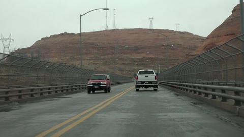 Arizona driving POV across Glen Canyon Dam bridge 4K Footage