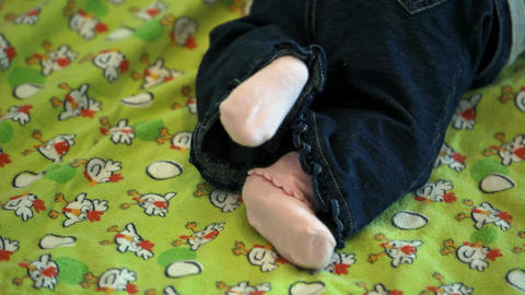 Baby legs kicking on blanket Footage
