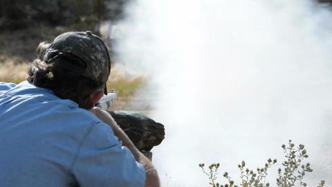 Black powder rifle over shoulder Slow P HD 2264 Footage