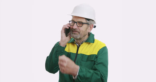 Portrait of old senior business man in suit and helmet Isolated over white Live Action