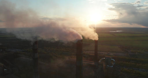 Aerial view. Chimney pollution pipes with grey smoke. Environmental pollution Live Action