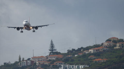 Airliner Lands at Madeira Funchal Airport. Airbus A 321 UltraHD 4K 2160p Video Live Action