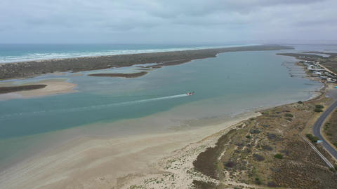Aerial footage of a sand dredger returning to port at the mouth of the River Murray in regional Acción en vivo