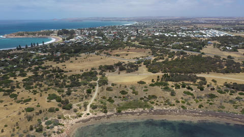 Drone aerial footage flying towards the town of Port Elliot in South Australia Live Action