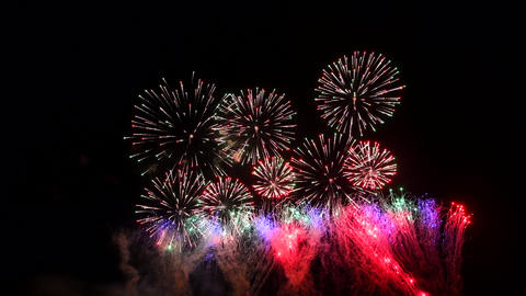 Fireworks show in the night sky, isolated on black background Live Action