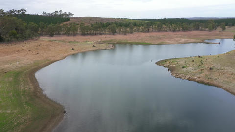 Drone footage of a large fresh water reservoir in Australia being challenged by severe drought Live Action