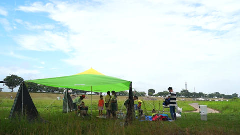 Scenery of the riverbank camp, tent and sky Live Action