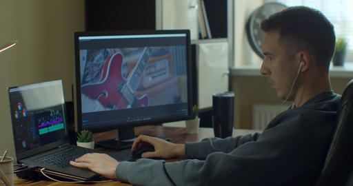 Man working on computer with Two Monitors Video editing. Monitor the computer Live Action