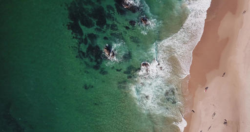 Ocean coastline from a bird's-eye view Waves ride on a deserted sandy ocean Live Action